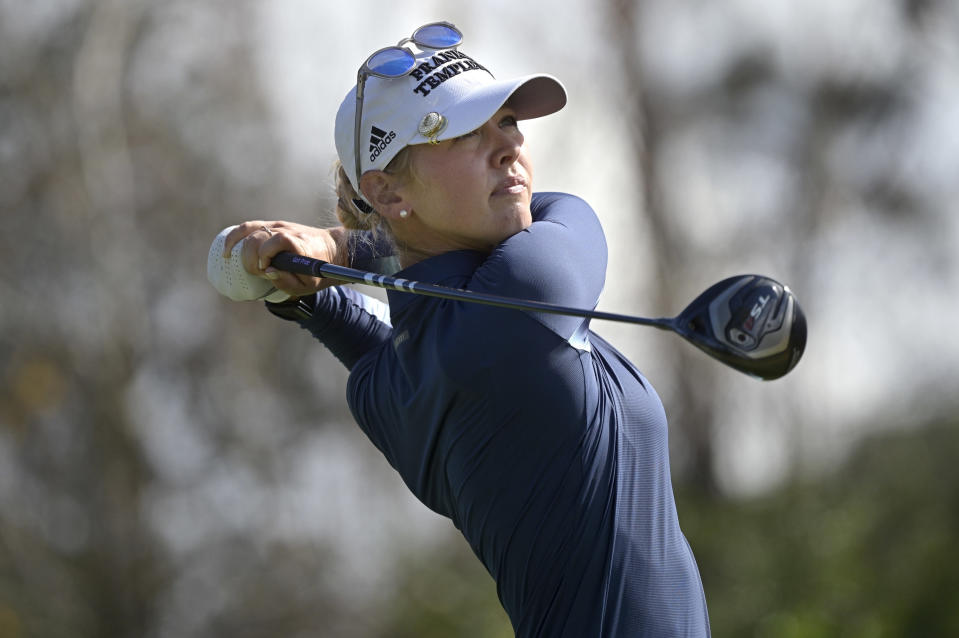 Jessica Korda watches her tee shot on the seventh hole during the final round of the Tournament of Champions LPGA golf tournament, Sunday, Jan. 24, 2021, in Lake Buena Vista, Fla. (AP Photo/Phelan M. Ebenhack)