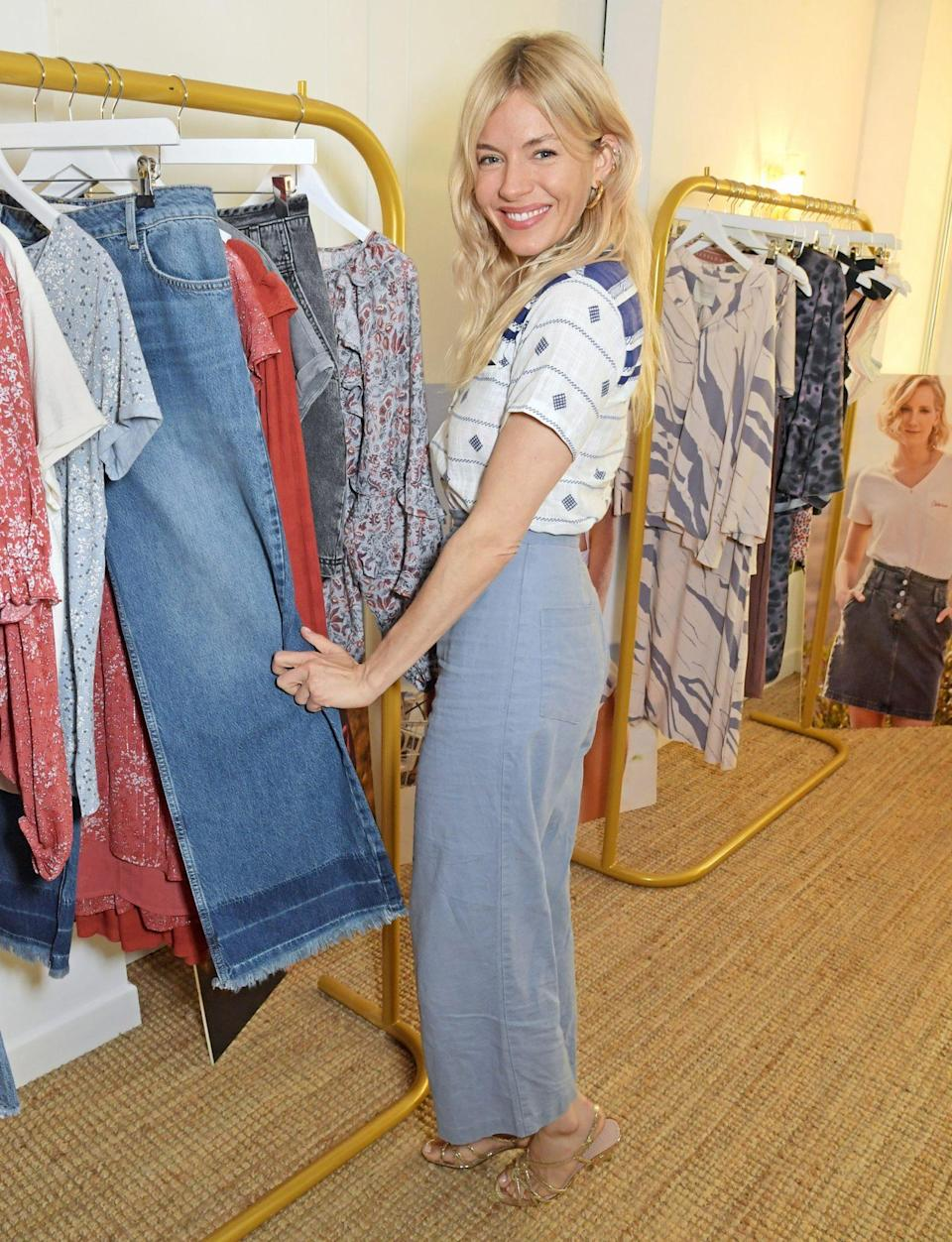 <p>Sienna Miller lends her star power to sister Savannah on June 10 at the launch of the Savannah Miller x Next collection at SohoWorks in London.</p>