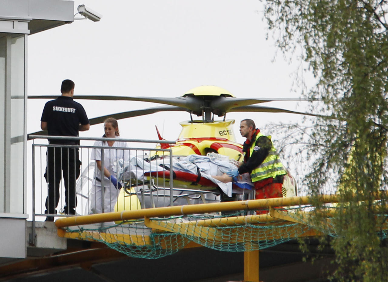 An person injured at the youth camp on the island of Utoya is taken from a helicopter into the Ullevaal Hospital in Oslo Friday July 22, 2011. At Utoya, an island outside Oslo, a gunman dressed in a police uniform opened fire at a Labor Party youth camp, shooting several youths, party spokesman Per Gunnar Dahl told The Associated Press. (AP Photo/Scanpix, Hakon Mosvold Larsen) NORWAY OUT