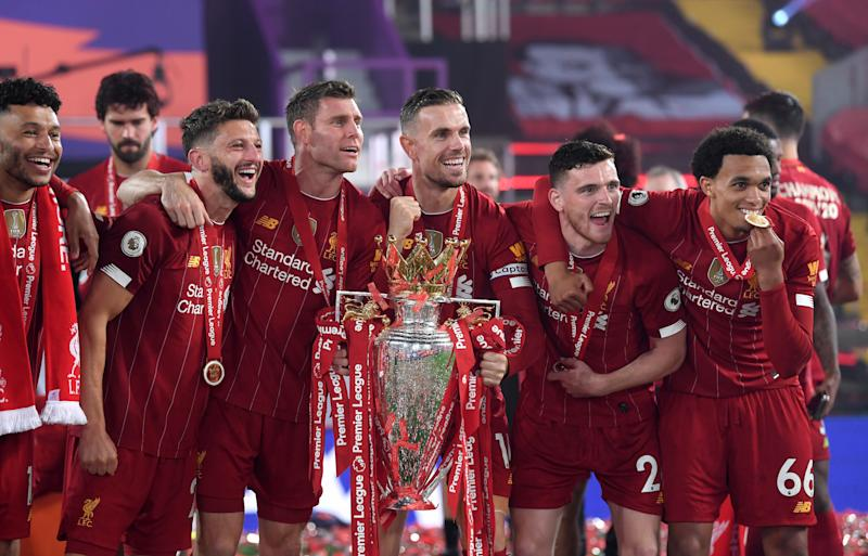 Left to right, Liverpool's Alex Oxlade-Chamberlain, Adam Lallana, James Milner, Jordan Henderson, Andrew Robertson and Trent Alexander-Arnold celebrate with the Premier League trophy after the Premier League match at Anfield, Liverpool. (Photo by Laurence Griffiths/PA Images via Getty Images)