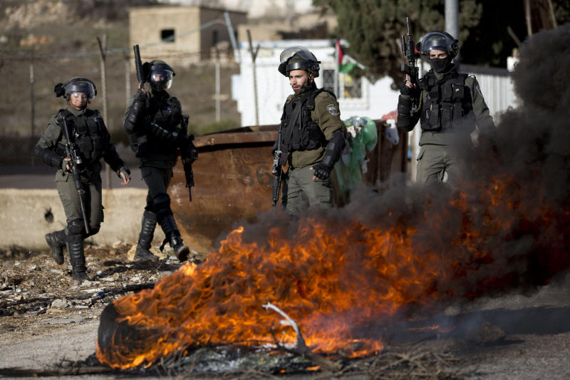 Israeli troops take their position during clashes with Palestinian demonstrators as they protest Middle East peace plan announced Tuesday by US President Donald Trump, which strongly favors Israel, at Beit El checkpoint, near the West Bank city of Ramallah, Wednesday, Jan 29, 2020 (AP Photo/Majdi Mohammed)