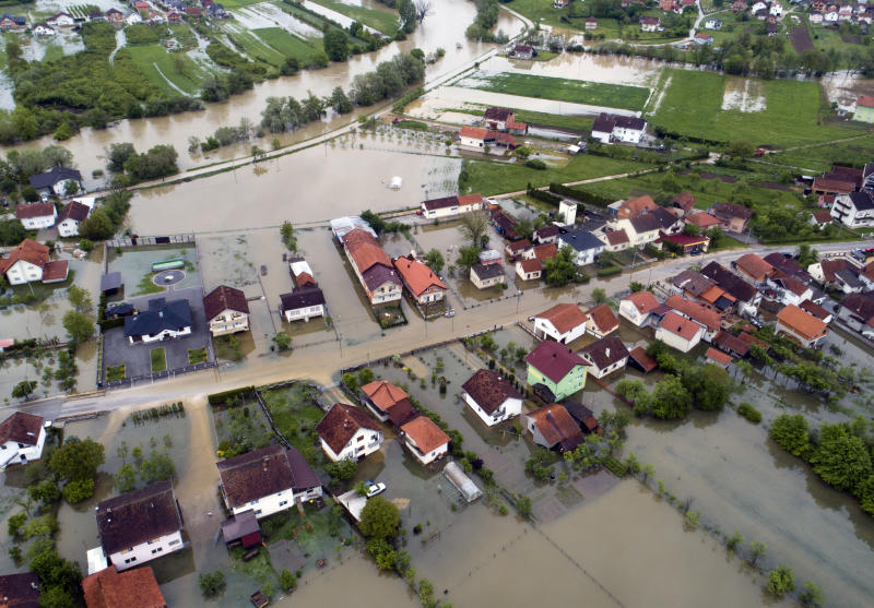 This aerial photo shows flooded neighborhood in Sanski Most, Bosnia-Herzegovina, Tuesday, May 14, 2019. Homes and roads have been flooded in parts of Bosnia after rivers broke their banks following heavy rains, triggering concerns Tuesday of a repeat of floods five years ago when dozens died. (AP Photo/Darko Bandic)