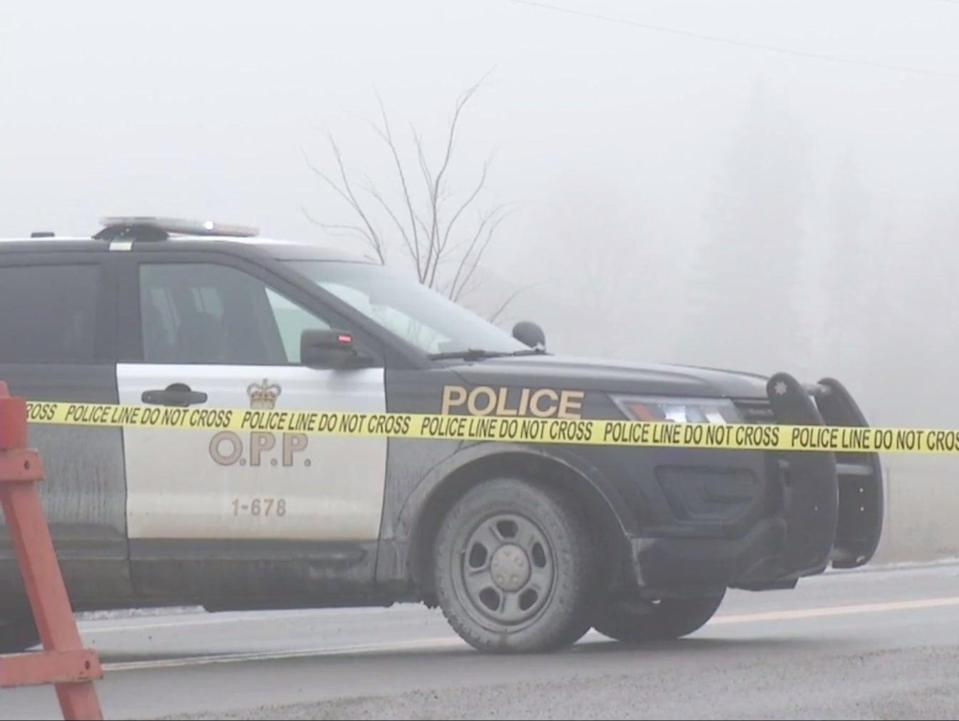 An Ontario police car on Pigeon Lake Road, where a one-year-old was shot in an alleged kidnap attempt  (Global News Canada)