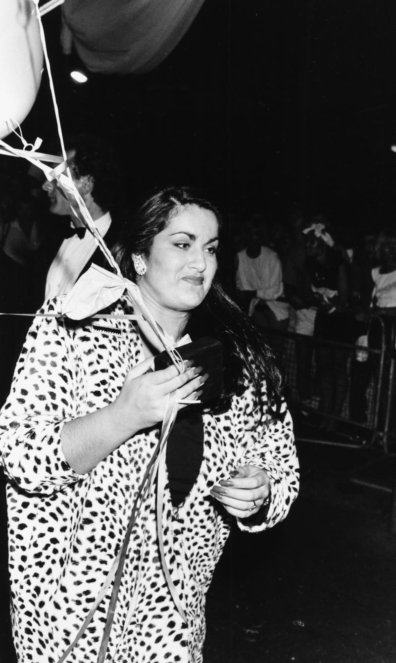 Melanie Panayiotou, sister of singer George Michael, holding balloons as she attends the Wham! farewell party, London, July 8th 1986. (Photo: Dave Hogan/Getty Images)