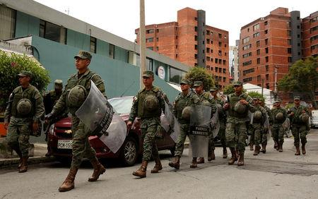 Soldiers patrol a street near the Electoral National Council  (CNE) headquarters prior to Sunday presidential election in Quito