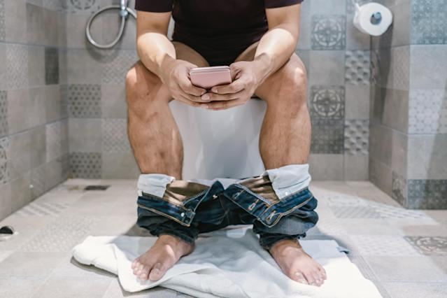 Around 50% of people living the UK take their phone to the toilet, a study suggests. (Getty)