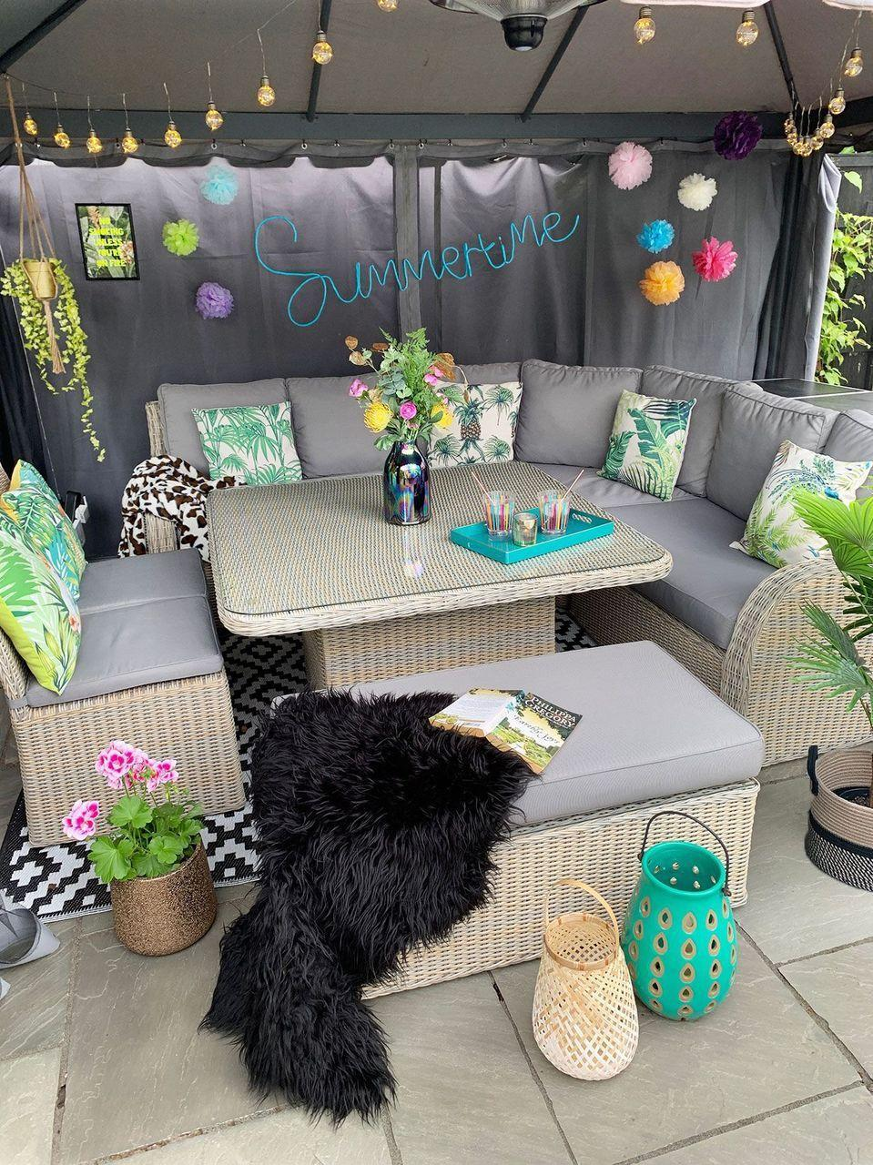 """<p>It's summertime and the living's easy thanks to this colorful and sunny gazebo refresh. But this charming hideaway can be enjoyed year-round, thanks to a fabric awning. </p><p><strong>Get the look at <a href=""""https://www.caradise.co.uk/colourful-garden-patio-gazebo-decor-on-a-budget/"""" rel=""""nofollow noopener"""" target=""""_blank"""" data-ylk=""""slk:Caradise"""" class=""""link rapid-noclick-resp"""">Caradise</a>. </strong></p><p><a class=""""link rapid-noclick-resp"""" href=""""https://www.amazon.com/Birthday-Celebration-Halloween-Christmas-Decoration/dp/B075BHNS7T/?tag=syn-yahoo-20&ascsubtag=%5Bartid%7C10050.g.30932979%5Bsrc%7Cyahoo-us"""" rel=""""nofollow noopener"""" target=""""_blank"""" data-ylk=""""slk:SHOP PAPER POM-POMS"""">SHOP PAPER POM-POMS</a></p>"""