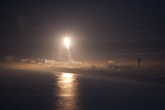 A NASA Terrier-Improved Orion sounding rocket roars toward space on a mission to create glowing red clouds above Earth on Jan. 29, 2013. The rocket launched from NASA's seaside Wallops Flight Facility on Wallops Island, Va.
