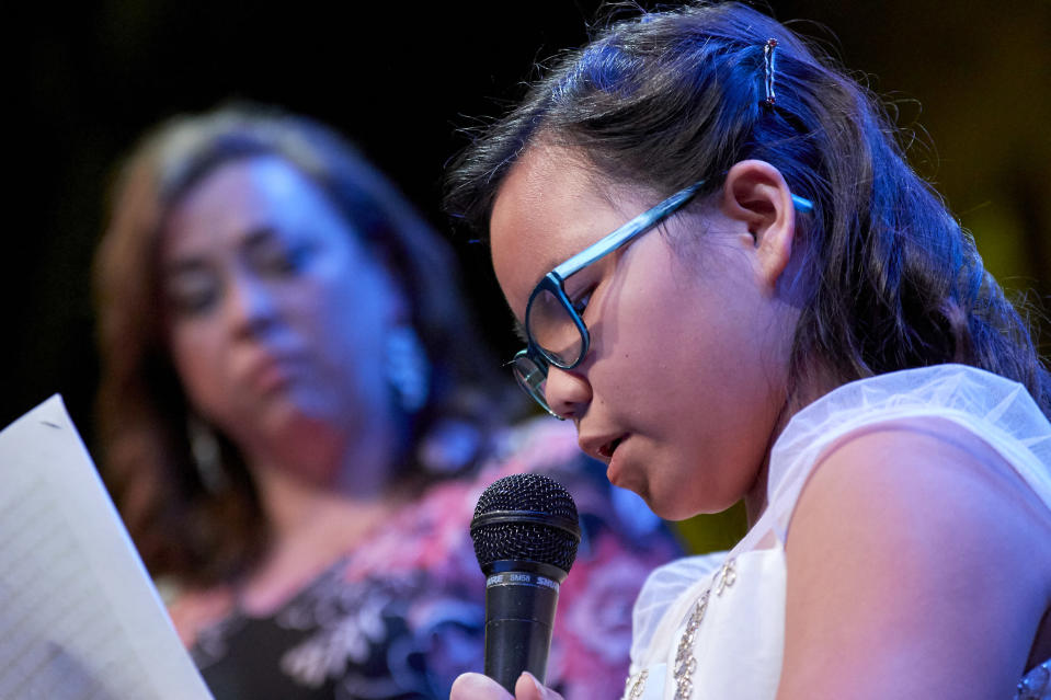 Michelle Benson looks on as her daughter Mei Mei spoke recently at a fundraising event for One Heartland. (One Heartland)