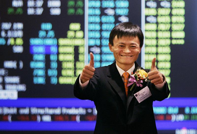 FILE - In this Nov. 6, 2007 file photo, Jack Ma, founder and CEO of Alibaba, celebrates at his company listing ceremony at the Hong Kong Stock Exchange. The mammoth IPO planned by e-commerce giant Alibaba Group highlights founder Ma's improbable rise to China's entrepreneur-in-chief. (AP Photo/Kin Cheung, File)