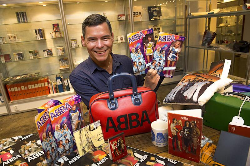 FILE- File photo from June 26, 2013, that shows Tomas Nordin among some of the 25,000 items in his ABBA collection that were sold at Stockholm auction house over the weekend of 10-11 Aug. 2013. Stockholm's Auktionsverk on Monday said the stash of ABBA items sold for 560,000 Swedish kronor ($86,000) (AP photo / Scanpix Sweden /Jonas Ekströmer) ** SWEDEN OUT **