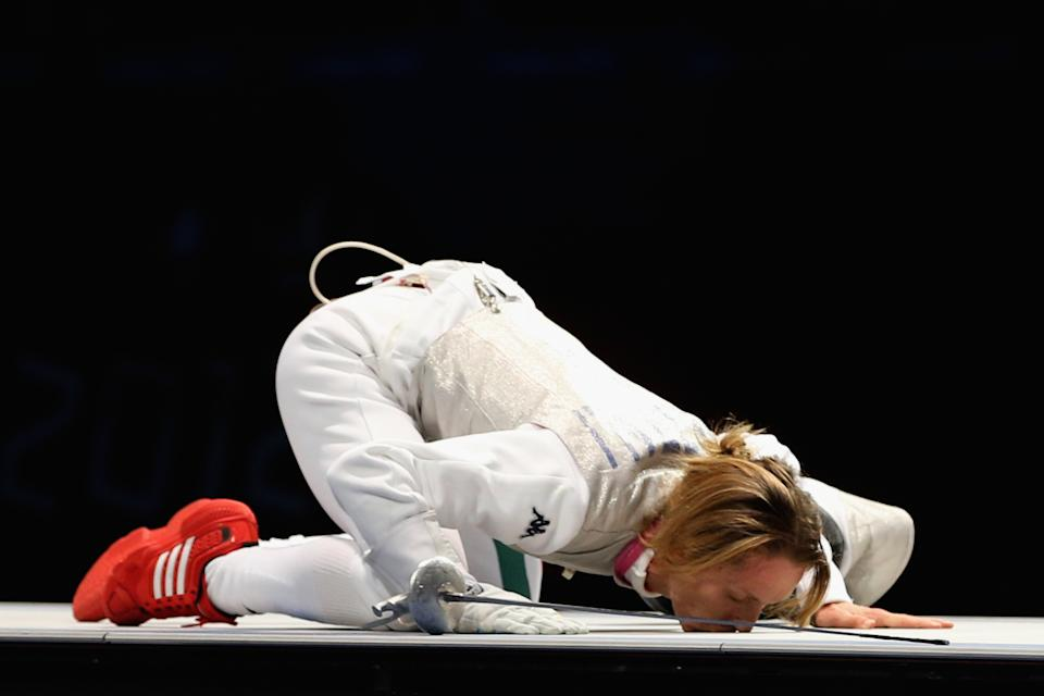 LONDON, ENGLAND - AUGUST 02: Valentina Vezzali of Italy kisses the mat as she celebrates winning gold during her contest with Larisa Korobeynikova of Russia in the Women's Foil Team Fencing gold medal match against Russia on Day 6 of the London 2012 Olympic Games at ExCeL on August 2, 2012 in London, England. (Photo by Hannah Johnston/Getty Images)