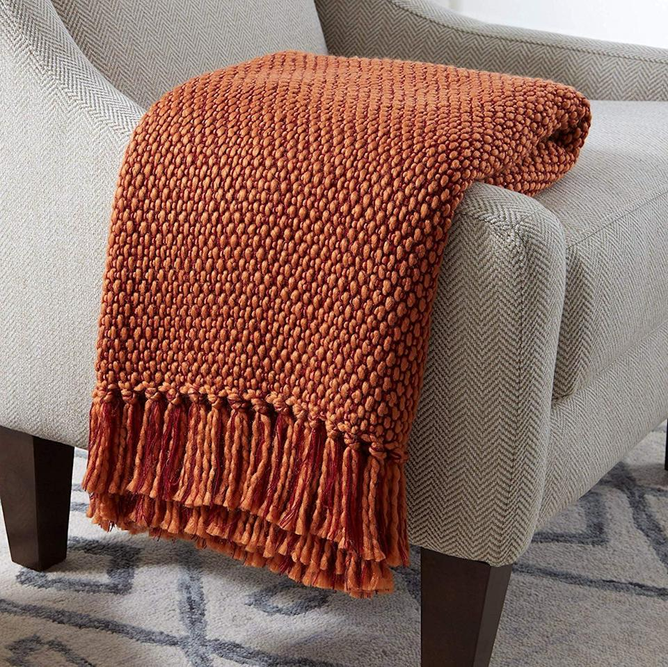 <p>Made with acrylic yarn, this <span>Stone & Beam Modern Woven Farmhouse Throw Blanket</span> ($49) will never look frumpy on the couch.</p>