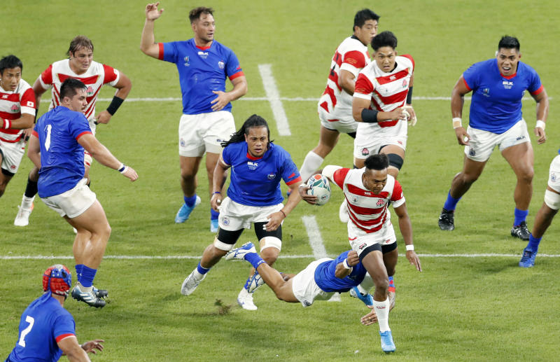 Japan's Kotaro Matsushima runs through the Samoan defence during the Rugby World Cup Pool A game at City of Toyota Stadium between Japan and Samoa in Tokyo City, Japan, Saturday, Oct. 5, 2019.(Kyodo News via AP)