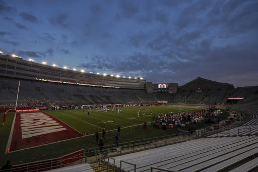 The seats at Camp Randall Stadium are empty during the second half of an NCAA college football game between Wisconsin and Indiana Saturday, Dec. 5, 2020, in Madison, Wis. (AP Photo/Morry Gash)