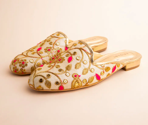 """<a href=""""https://fave.co/36v9Ykr"""">BUY HERE</a> Off-white and pink avery mules with embroidery and embellishments by Eridani, from Nykaa Fashion, <strong>for Rs. 2,000</strong>"""