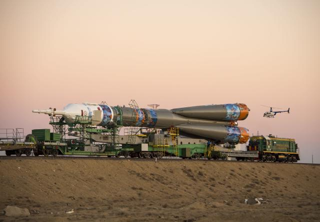 BAIKONUR, KAZAKHSTAN - NOVEMBER 05: In this handout image provided by NASA, The Soyuz TMA-11M rocket, adorned with the logo of the Sochi Olympic Organizing Committee and other related artwork, is rolled out to the launch pad by train at the Baikonur Cosmodrome on November 5, 2013 in Baikonur, Kazakhstan. Launch of the Soyuz rocket is scheduled for November 7 and will send Expedition 38 Soyuz Commander Mikhail Tyurin of Roscosmos, Flight Engineer Rick Mastracchio of NASA and Flight Engineer Koichi Wakata of the Japan Aerospace Exploration Agency on a six-month mission aboard the International Space Station. Photo Credit: (Photo by Bill Ingalls/NASA via Getty Images)