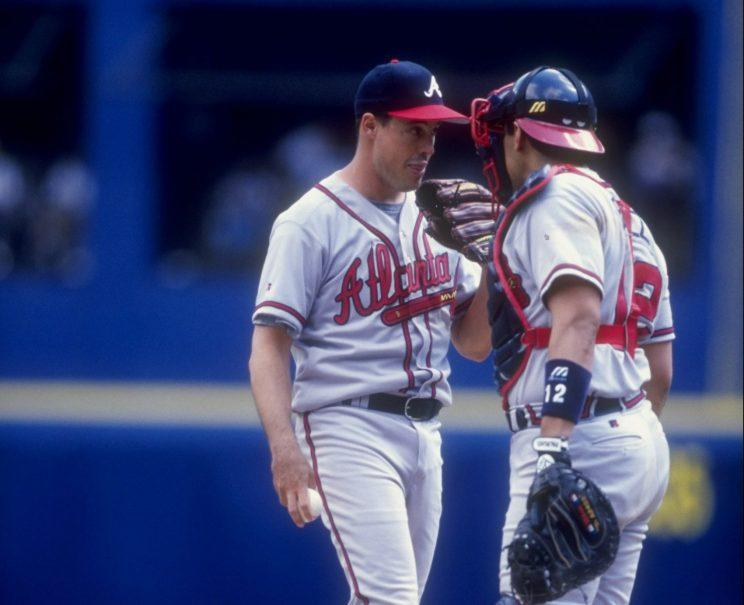 Greg Maddux and catcher Eddie Perez, circa 1998. (Getty Images)