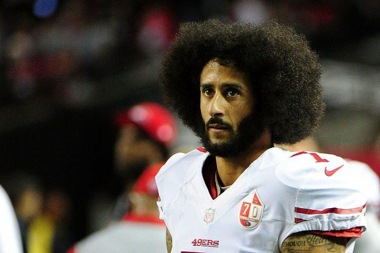 Michael Vick's advice for Colin Kaepernick: cut your hair. (Getty)