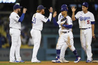 The Los Angeles Dodgers celebrate after a 5-3 win over the Arizona Diamondbacks in a baseball game Wednesday, Sept. 15, 2021, in Los Angeles. (AP Photo/Ashley Landis)