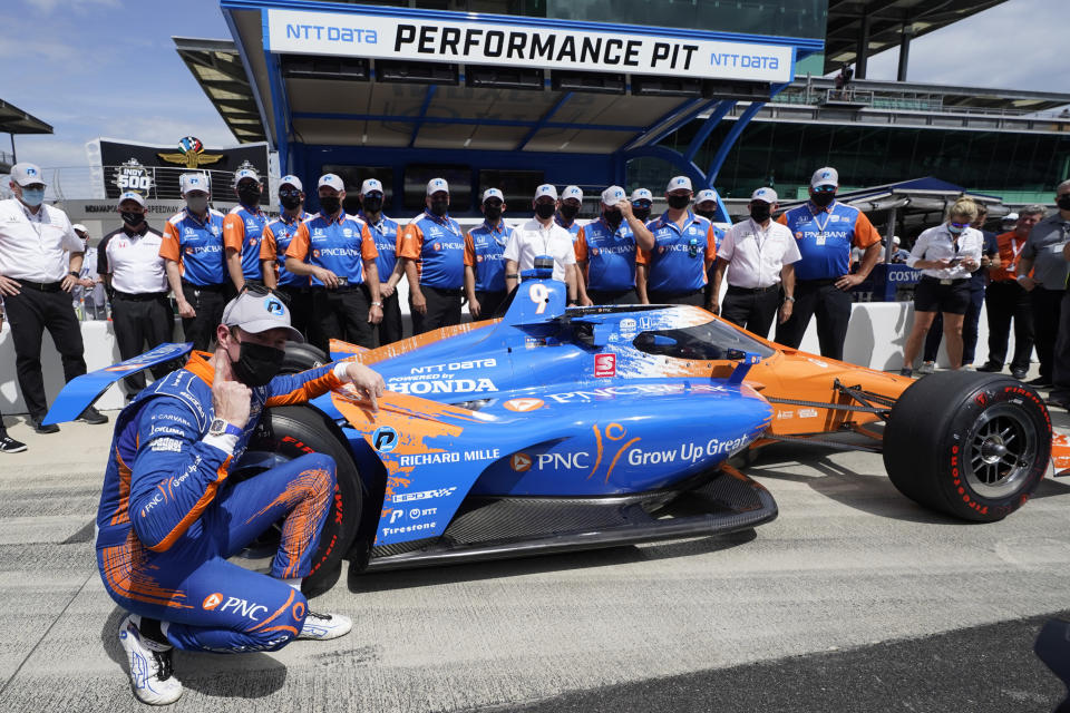 Scott Dixon, of New Zealand, celebrates after winning the pole for the Indianapolis 500 auto race at Indianapolis Motor Speedway, Sunday, May 23, 2021, in Indianapolis. (AP Photo/Darron Cummings)