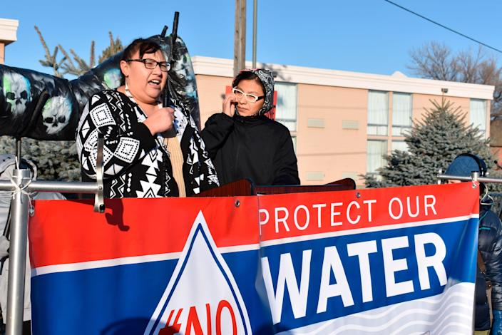 Angeline Cheek, left, a community organizer from the Fort Peck Indian Reservation, speaks about the potential environmental damage from the Keystone XL oil pipeline from Canada during a demonstration in Billings, Mont. on Tuesday, Oct. 29, 2019. (AP Photo/Matthew Brown)