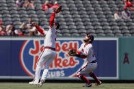 Los Angeles Angels shortstop Jose Iglesias, left, catches a fly ball with third baseman David Fletcher, right, backing him up, on a ball hit by Oakland Athletics designated hitter Mitch Moreland during the seventh inning of a baseball game in Anaheim, Calif., Saturday, July 31, 2021. (AP Photo/Alex Gallardo)