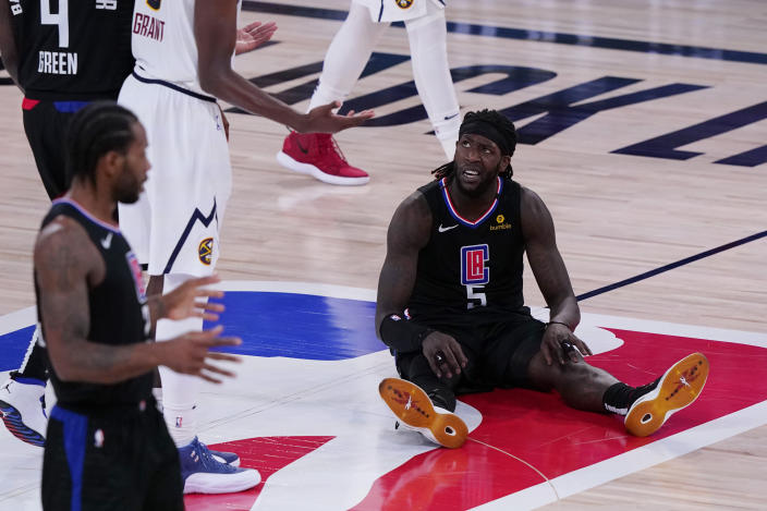 """Los Angeles Clippers forward <a class=""""link rapid-noclick-resp"""" href=""""/nba/players/5492/"""" data-ylk=""""slk:Montrezl Harrell"""">Montrezl Harrell</a> (5) reacts after a play against the Denver Nuggets in a Game 7 loss. (AP Photo/Mark J. Terrill)"""