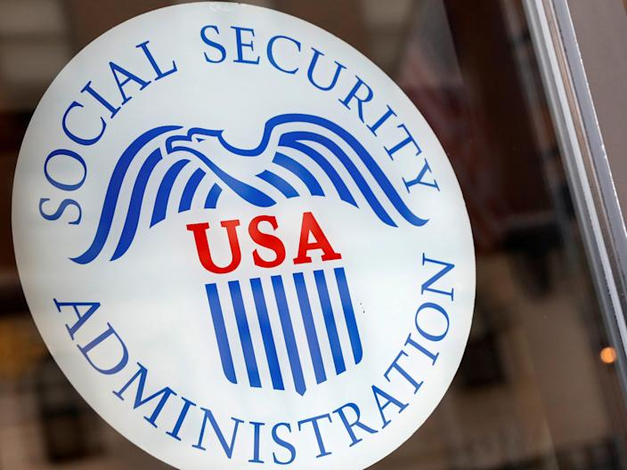 FILE PHOTO A sign is seen on the entrance to a Social Security office in New York City, U.S., July 16, 2018. REUTERS/Brendan McDermid/File Photo