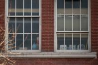 Text books and a globe are seen on a window at P.S. 134 elementary school during the COVID-19 pandemic in the Brooklyn borough of New York City