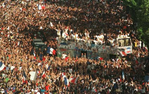 FILE - In this Monday, July 13, 1998 file photo, the French World Cup soccer team parades through the Champs-Elysees avenue in Paris after beating Brazil 3-0 in the World Cup final the day before. The 21st World Cup begins on Thursday, June 14, 2018, when host Russia takes on Saudi Arabia. (AP Photo/Gael Cornier,File)