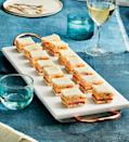 """<p><strong>Recipe: <a href=""""https://www.southernliving.com/recipes/mini-tomato-sandwiches-bacon-mayonnaise-recipe"""" rel=""""nofollow noopener"""" target=""""_blank"""" data-ylk=""""slk:Mini Tomato Sandwiches With Bacon Mayonnaise"""" class=""""link rapid-noclick-resp"""">Mini Tomato Sandwiches With Bacon Mayonnaise</a></strong></p> <p>Just as effortless as they are delicious, these tomato sandwiches come together in 20 minutes. </p>"""
