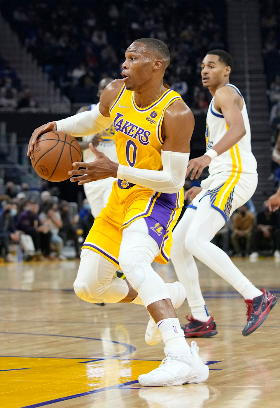 The Lakers' Russell Westbrook drives Friday against the Warriors at Chase Center.