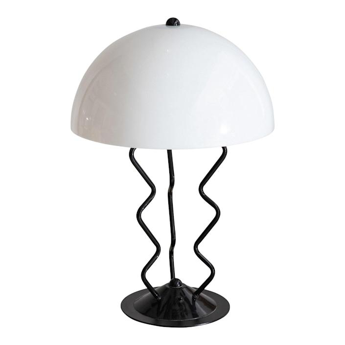"""$1250, Chairish. <a href=""""https://www.chairish.com/product/2972831/late-20th-century-memphis-style-metal-squiggle-table-lamp-with-acrylic-dome-shade"""" rel=""""nofollow noopener"""" target=""""_blank"""" data-ylk=""""slk:Get it now!"""" class=""""link rapid-noclick-resp"""">Get it now!</a>"""