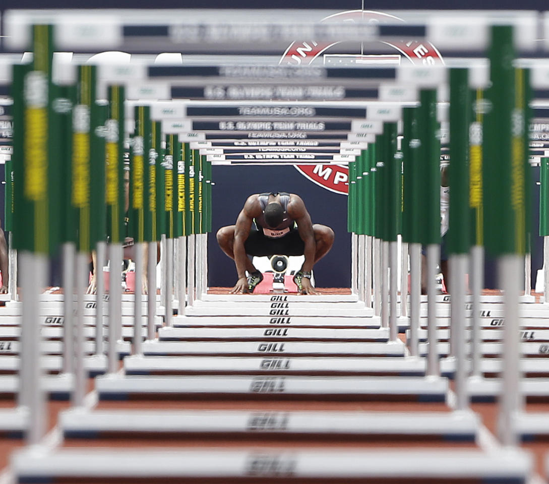 David Oliver prepares to start in the men's 110 meter hurdles qualifying round at the U.S. Olympic Track and Field Trials Friday, June 29, 2012, in Eugene, Ore. (AP Photo/Eric Gay)