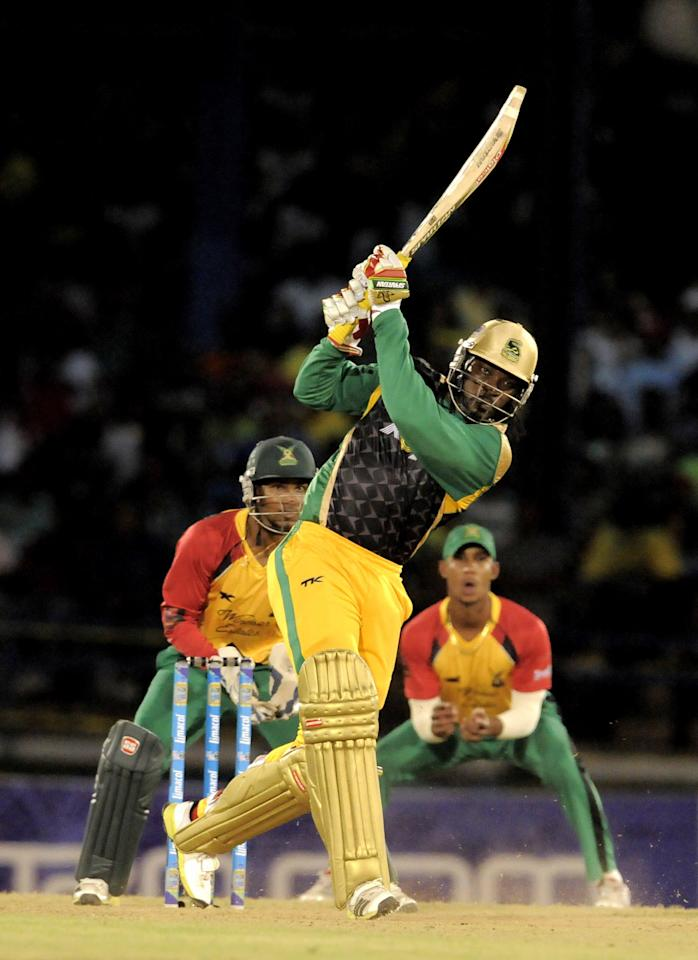 PORT OF SPAIN, TRINIDAD AND TOBAGO - AUGUST 24:  Chris Gayle of Jamaica Tallawahs hits a 4 against Guyana Amazon Warriors during the Final of the Caribbean Premier League between Guyana Amazon Warriors v Jamaica Tallawahs at Queens Park Oval on August 24, 2013 in Port of Spain, Trinidad and Tobago. (Photo by Randy Brooks/Getty Images Latin America for CPL)