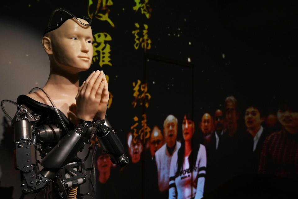 """""""This robot will never die, it will just keep updating itself and evolving,"""" priest Tensho Goto told AFP."""