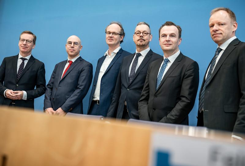 11 March 2020, Berlin: Michael Hüther (l-r), Director of the Institut der deutschen Wirtschaft Köln, Gabriel Felbermayr, President of the Institut für Weltwirtschaft Kiel, Sebatian Dullien, Director of the Institut Makroökonomie und Konjunkturforschung, Peter Bofinger, Julius-Maximilians-Universität Würzburg, Jens Südekum, Heinrich-Heine-universität Düsseldorf, and Clemens Fuest, President of the ifo Institute, Leibnitz-Institut für Wirtschaftsforschung Uni München, take part in a press conference of the economic research institutes on the consequences of the corona crisis. Photo: Michael Kappeler/dpa (Photo by Michael Kappeler/picture alliance via Getty Images)