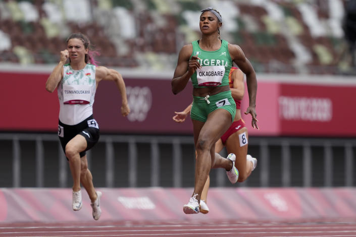 Blessing Okagbare, of Nigeria, wins a heat in the women's 100-meter run at the 2020 Summer Olympics, Friday, July 30, 2021, in Tokyo. (AP Photo/Martin Meissner)