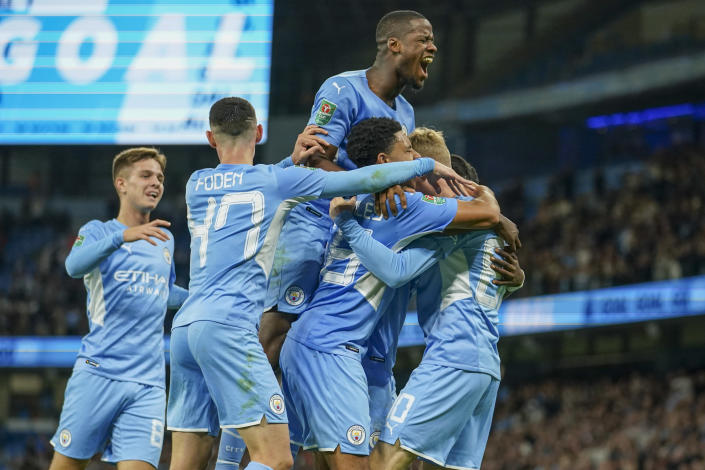 Manchester City's Cole Palmer, right, is congratulated by teammates after scoring his team's fifth goal during the English League Cup third round soccer match between Manchester City and Wycombe Wanderers at Etihad Stadium, in Manchester England, Tuesday, Sept. 21, 2021. (AP Photo/Dave Thompson)