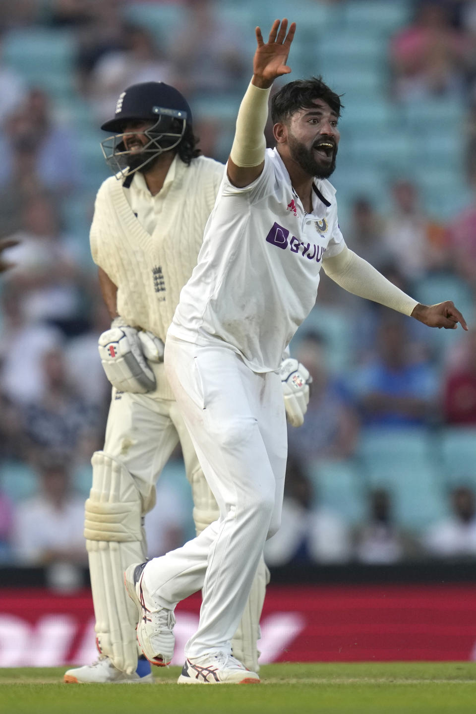 India's Mohammed Shami appeals unsuccessfully against England's Haseeb Hameed, left, on day four of the fourth Test match at The Oval cricket ground in London, Sunday, Sept. 5, 2021. (AP Photo/Kirsty Wigglesworth)