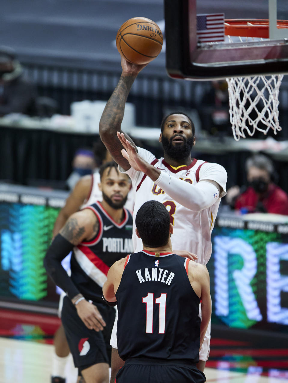 Cleveland Cavaliers center Andre Drummond, top, shoots over Portland Trail Blazers center Enes Kanter during the first half of an NBA basketball game in Portland, Ore., Friday, Feb. 12, 2021. (AP Photo/Craig Mitchelldyer)