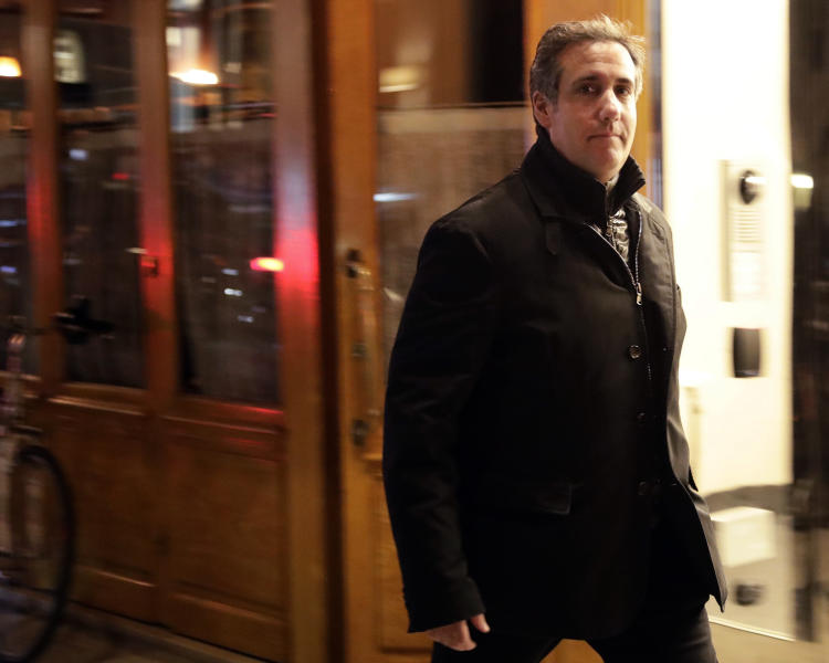 FILE - In this April 10, 2018, file photo, Michael Cohen, President Donald Trump's personal attorney, walks to his hotel in New York. A year ago Tuesday, April 9, 2019, FBI agents raided Cohen's home and office and some pundits declared it the beginning of the end of Donald Trump's presidency. And yet, there are mounting indications that Cohen's usefulness to federal prosecutors is drying up. (AP Photo/Frank Franklin II, File)
