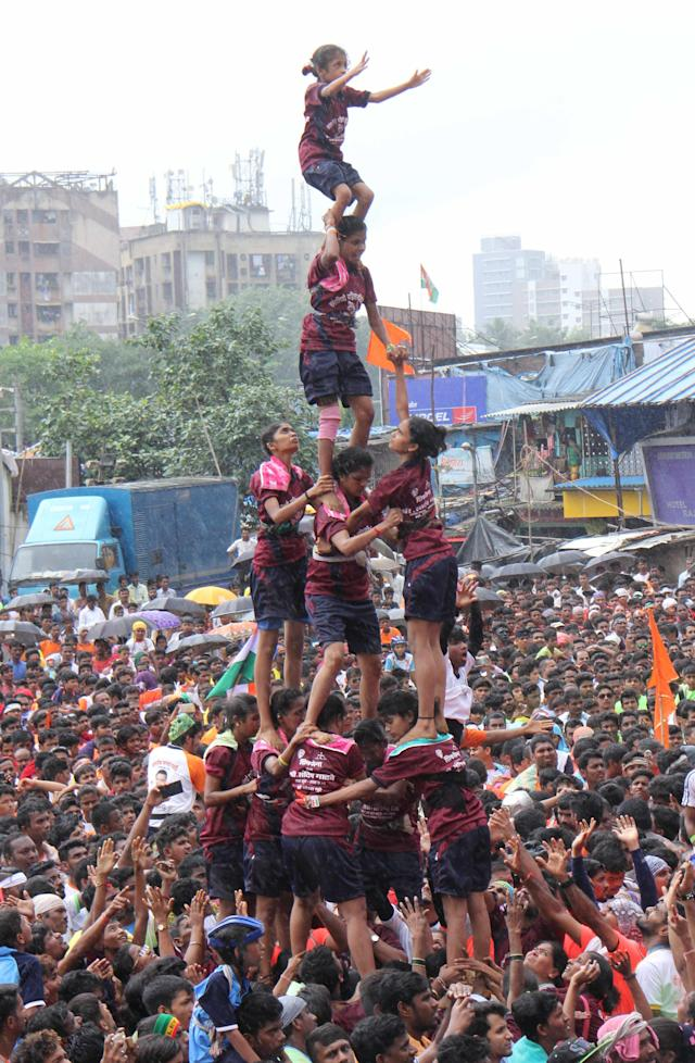 <p>Women from Mumbai form a human pyramid to break the' dahi-handi', a curd-pot suspended above during celebrations of the Hindu festival of 'Janmashtami'. </p>