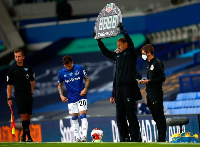 Everton assistant manager Duncan Ferguson holds up the substitutes board
