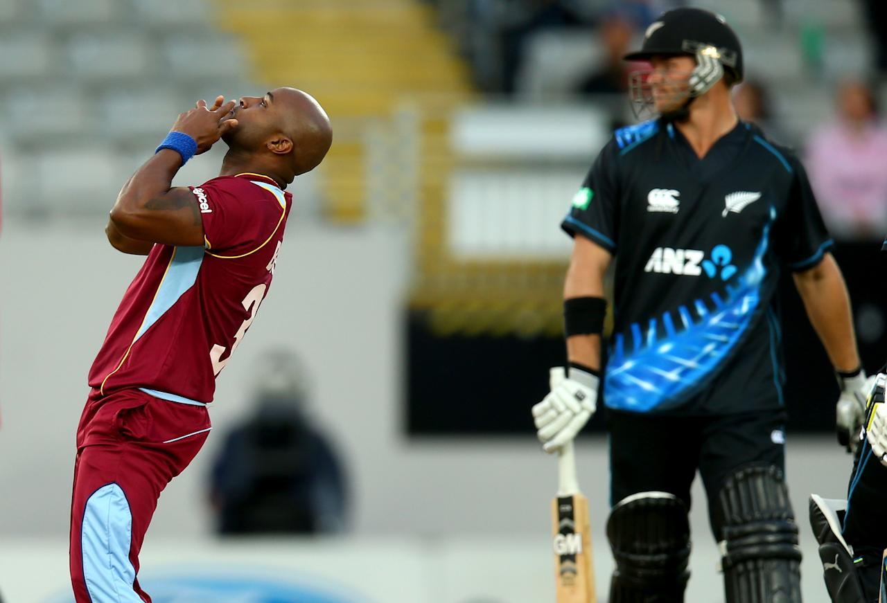 AUCKLAND, NEW ZEALAND - JANUARY 11:  Tino Best of the West Indies celebrates his wicket of Corey Anderson of New Zealand (R) during the first T20 between New Zealand and the West Indies at Eden Park on January 11, 2014 in Auckland, New Zealand.  (Photo by Phil Walter/Getty Images)