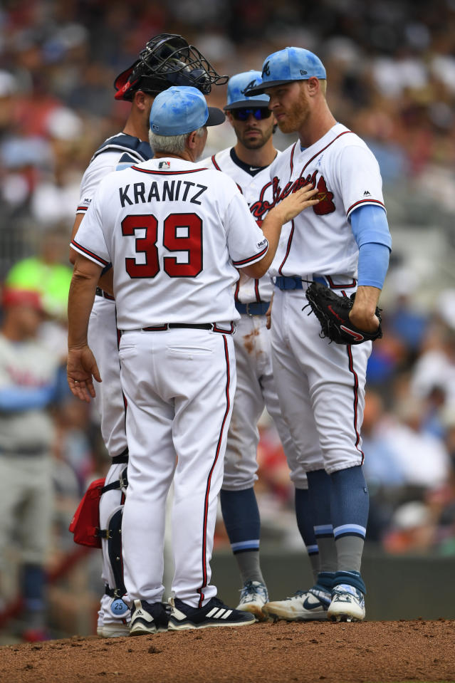 Atlanta Braves pitcher Mike Foltynewicz, right, is spoken to by pitching coach Rick Kranitz (39) after he loaded the bases with Philadelphia Phillies during the third inning of a baseball game Sunday, June 16, 2019, in Atlanta. (AP Photo/John Amis)