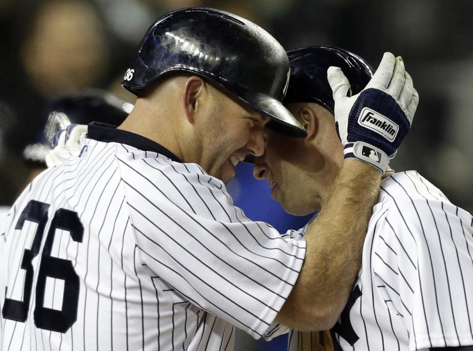 New York Yankees' Kevin Youkilis (36) congratulates teammate Brett Gardner after Gardner hit a third-inning solo home run in a baseball game against the Boston Red Sox at Yankee Stadium in New York, Thursday, April 4, 2013. (AP Photo/Kathy Willens)