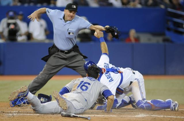 Home plate umpire Mike Everitt, top, calls Los Angeles Dodgers' Andre Ethier (16ft) out at the plate after a tag by Toronto Blue Jays catcher J.P. Arencibia during the seveth inning of a baseball game Tuesday, July 23, 2013, in Toronto. (AP Photo/The Canadian Press, Jon Blacker)