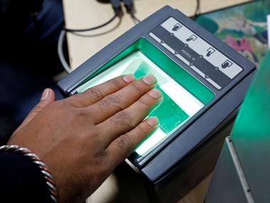 A woman goes through the process of finger scanning for the Unique Identification (UID) database system, Aadhaar. Image: Reuters
